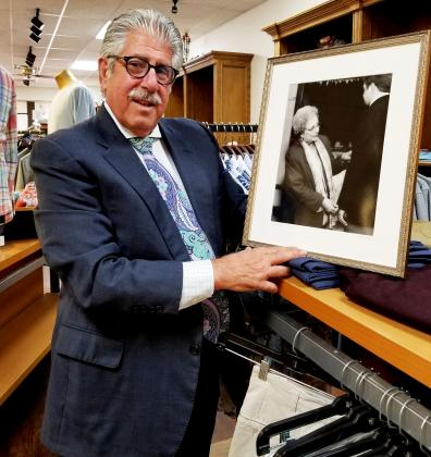 "Southwest Ledger photo by Debi DeSilver       Eddie Hamra and his grandson Kipton Wright, 8, hanging out on a summer's day at Edward's Men's Wear located at 405 SW C Ave. in Lawton. Eddie is holding a plaque from the Lawton-Fort Sill Chamber of Com- merce, which honored Edward's Men's Wear as the ""Small Family Owned Business of the Year"" in 2016."