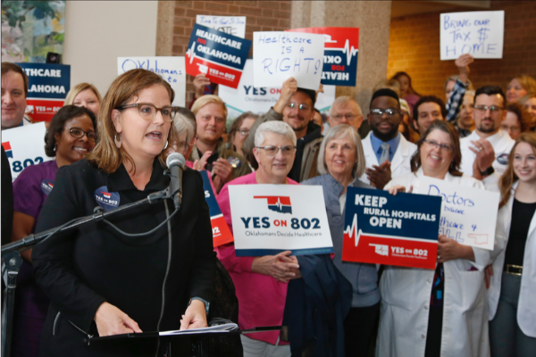 Amber England, who headed the campaign to put Medicaid expansion on the ballot in Oklahoma, speaks before supporters of Yes on 802 Oklahomans Decide Healthcare deliver petitions to the Oklahoma Secretary of State's office, Thursday, Oct. 24, 2019, in Oklahoma City. The signatures of about 178,000 registered voters are needed to get the question on the ballot, and supporters say they obtained about 313,000 signatures. (AP Photo/Sue Ogrocki)