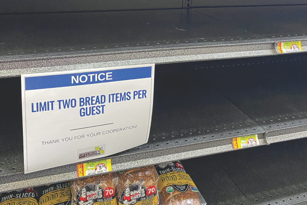 A sign informs customers to limit themselves to two bread items inside the Uptown Grocery in Edmond.