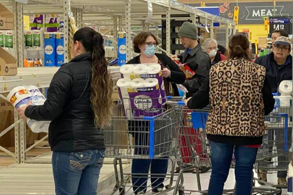 Customers rush to the toilet paper aisle at the Altus Walmart Supercenter. Ledger photo by Curtis Awbrey
