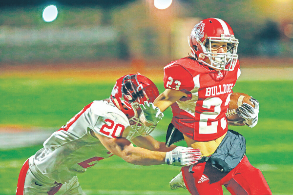 Cache's Hunter Tate attempts to break a tackle during a football game against Elgin Nov. 1, 2019. Rick Endicott Photography, file Cache's Hunter Tate attempts to break a tackle during a football game against Elgin Nov. 1, 2019.