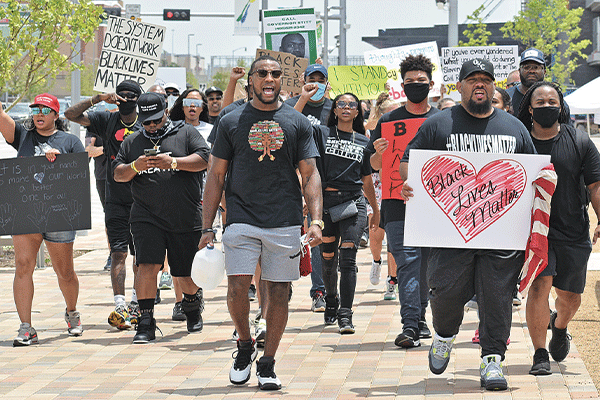 Justin Broiles, center, marches with a group during a recent Black Lives Matter rally in Oklahoma City. Ledger photos by Michael Kinney