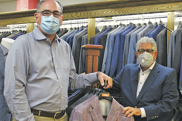 Mark Ramming and Eddie Hamra of Edward's Men's Wear, 405 S.W. C Ave. in Lawton  Ledger file photo by Curtis Awbrey