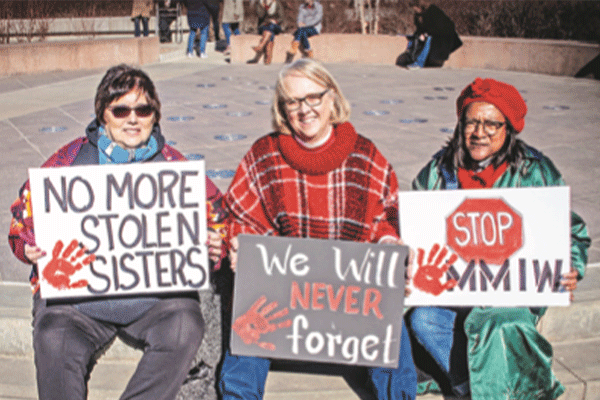 Women hold signs in protest of missing and murdered indigenous women during an annual Women's March in Tulsa Jan18.