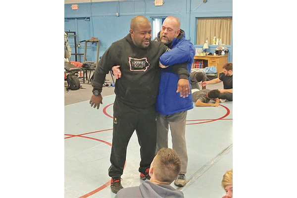 Dwight Hinson, left, coaches the Central Iowa Wrestling Club and Team Intensity, a wrestling program for youth in Ames. Hinson will be inducted into the Glen Grand Wrestling Hall of Fame of Iowa in 2021.