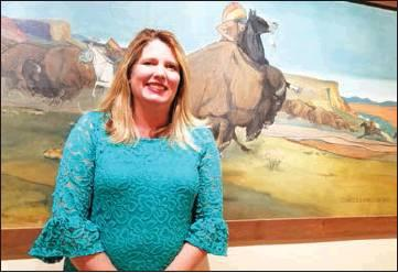 Southwest Ledger photo by Debi DeSilver Stacy Cramer Moore is shown standing in front of one of the many art pieces located at the Chisholm Trail Heritage Center in Duncan. She moved to Oklahoma in 1997 and loves the history and culture. As a biologist she is also fascinated with the environment, impressed that Oklahoma has at least nine distinct ecosystems.